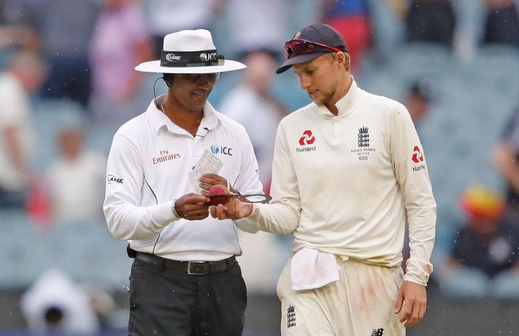 Joe Root and umpire Kumar Dharmasena inspect the ball