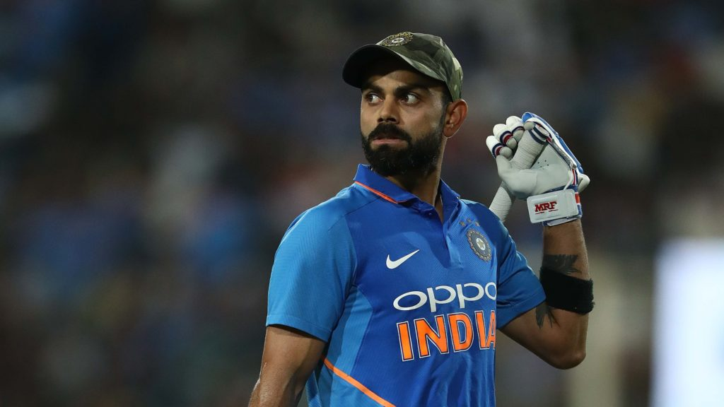 Virat Kohli led out an Indian team donned in camouflage caps