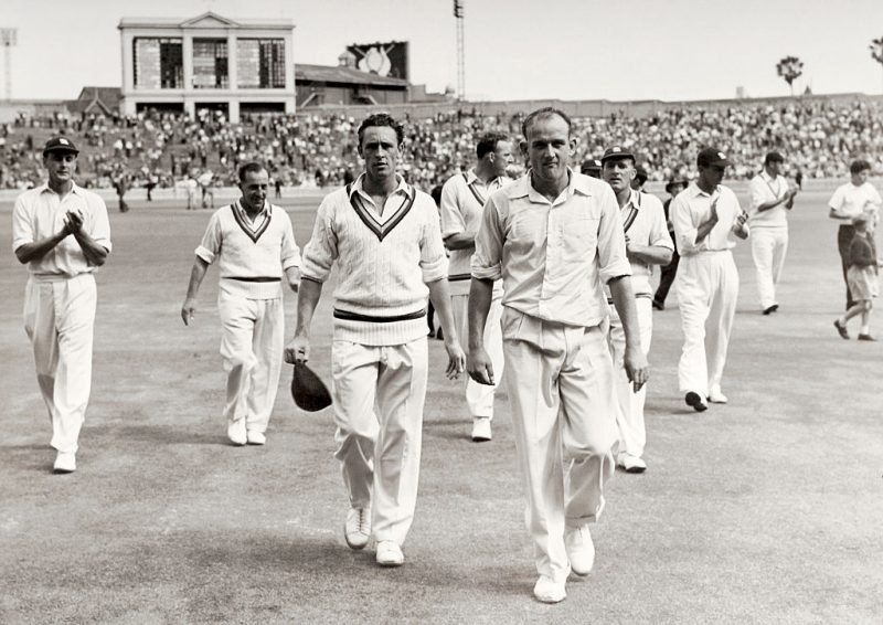 England's Frank Tyson (right) leading his team off the field after sealing a 38-run win over Australia in the Sydney Test in 1954