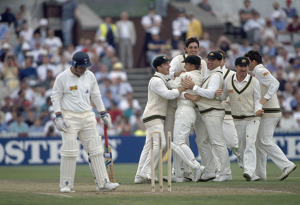 Shane Warne is mobbed by team-mates after the Ball of the Century