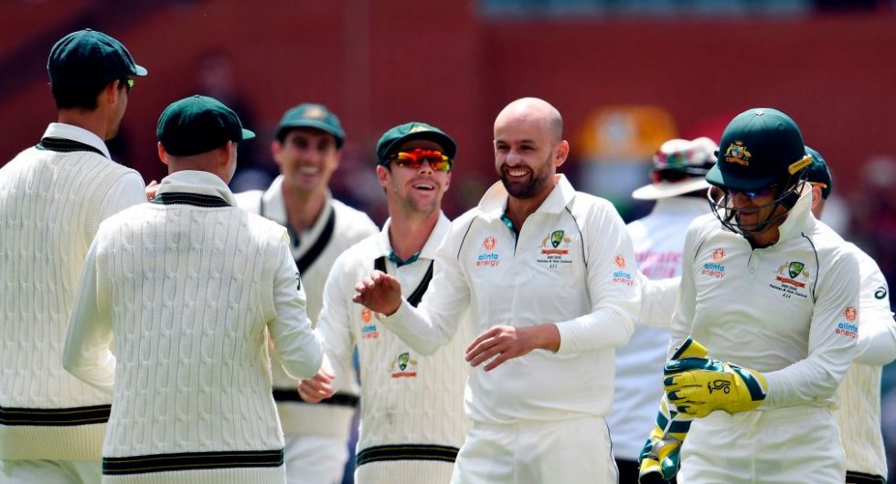Nathan Lyon celebrates his wicket of Pakistan's Shan Masood with teammates on day four of the second cricket Test match between Australia and Pakistan in Adelaide